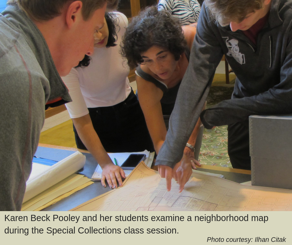 Karen Beck Pooley and her students examine a neighborhood map during the Special Collections class session.