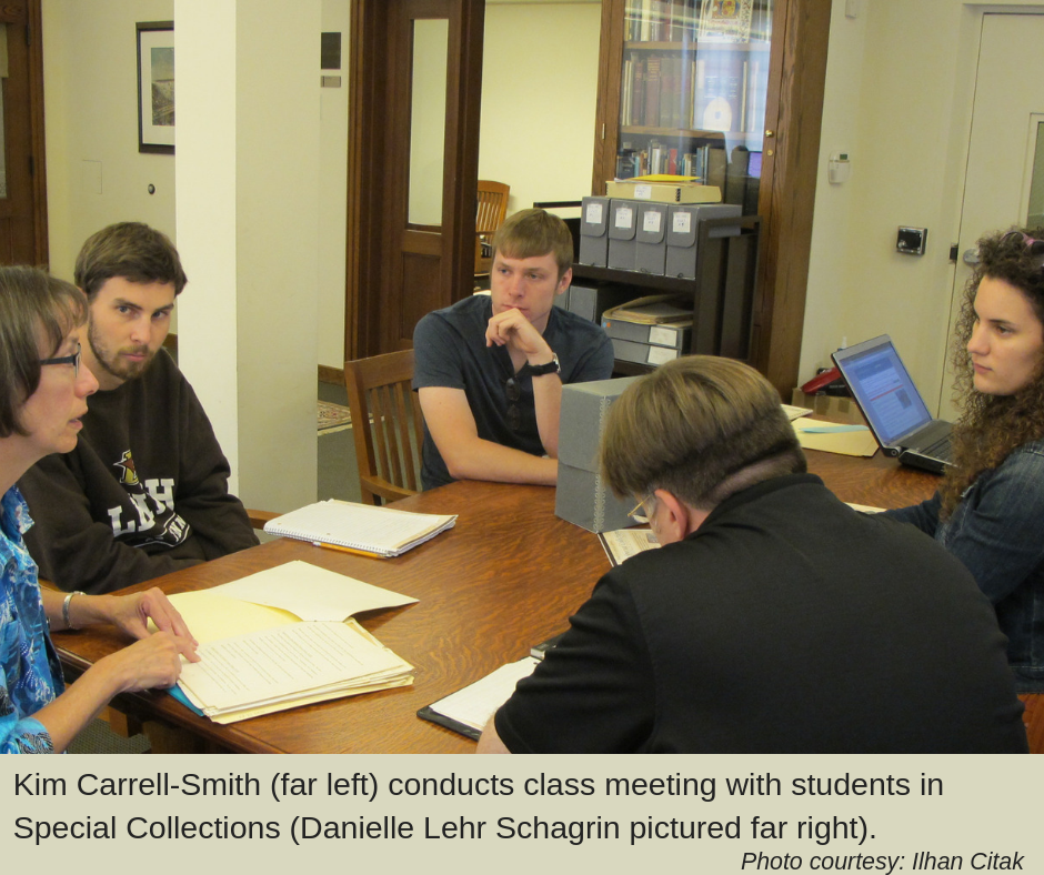 Kim Carrell-Smith (far left) conducts class meeting with students in Special Collections (Danielle Lehr Schagrin pictured far right).