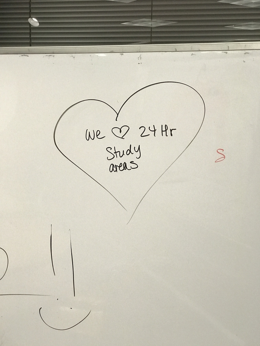 whiteboard message that reads we love 24 hour study areas