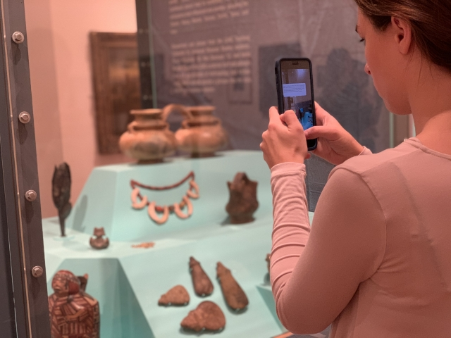Student at Lehigh University Art Galleries participating in [AR]T ADVENTURES augmented reality game