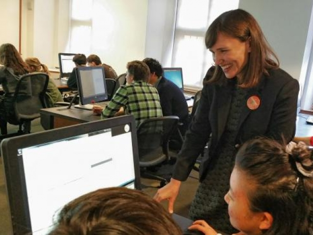 students and staff working in a computer lab on the transcribathon effort