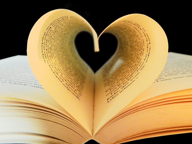 open book with heart created from two facing pages
