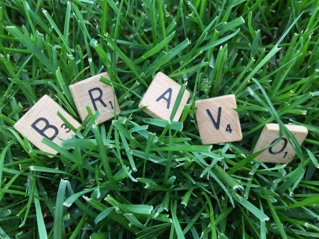 bravo spelled out in scrabble tiles