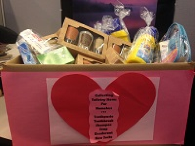 Box filled with donated personal care items