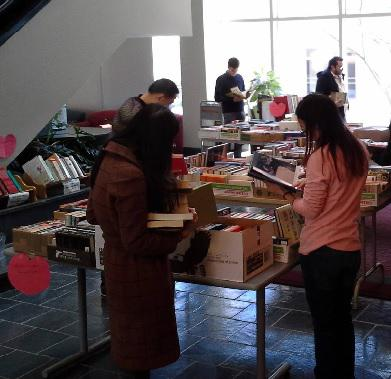 Students browsing books at the book sale