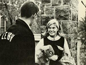 Male Lehigh student talks to female student in early 1970's photo