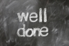 photo of the words well done written on chalkboard