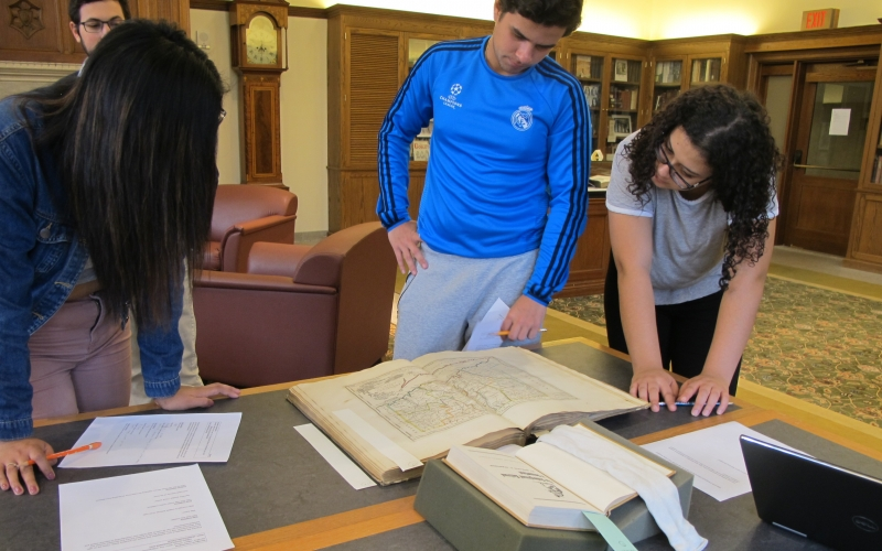 Students explore the geological aspects of the Underground Railroad by utilizing historical publications on slavery, rare maps, and atlases