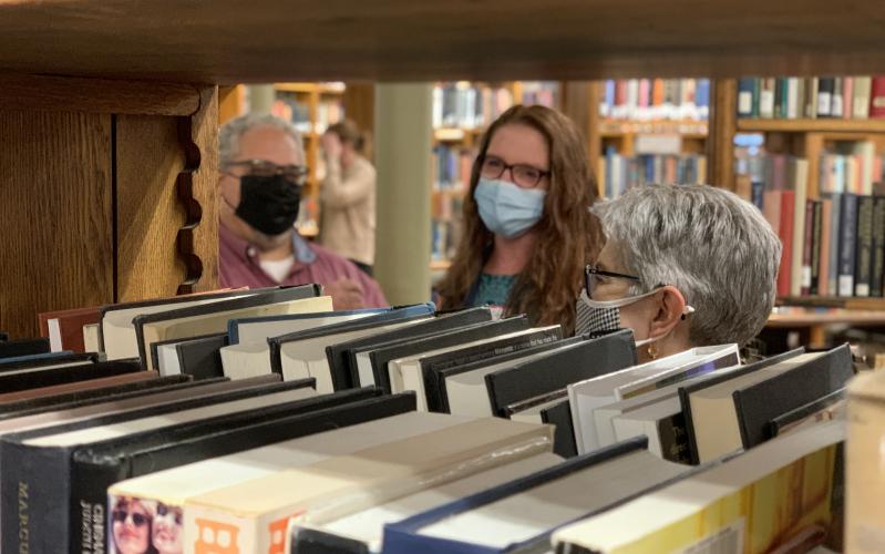 Guests mingling in book stacks in Linderman Library Rotunda
