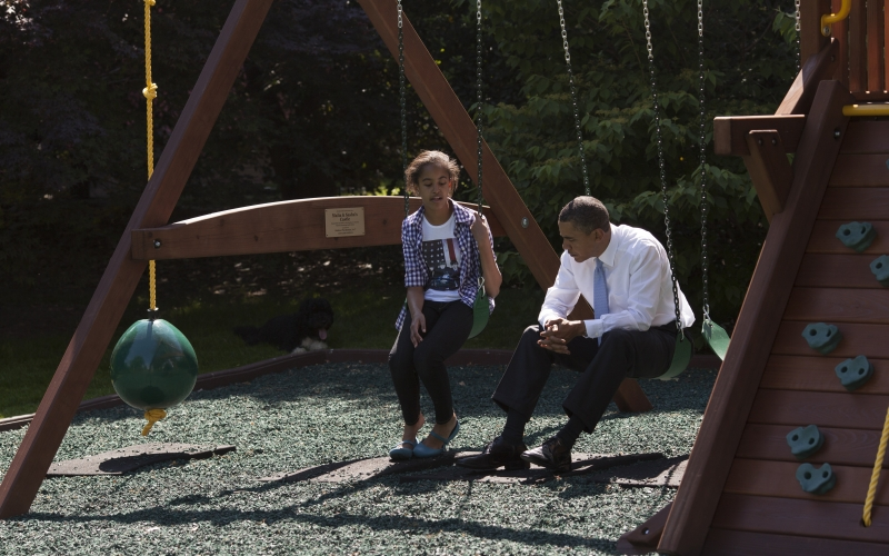President Barack Obama Talks with Malia Obama on the South Lawn of the White House